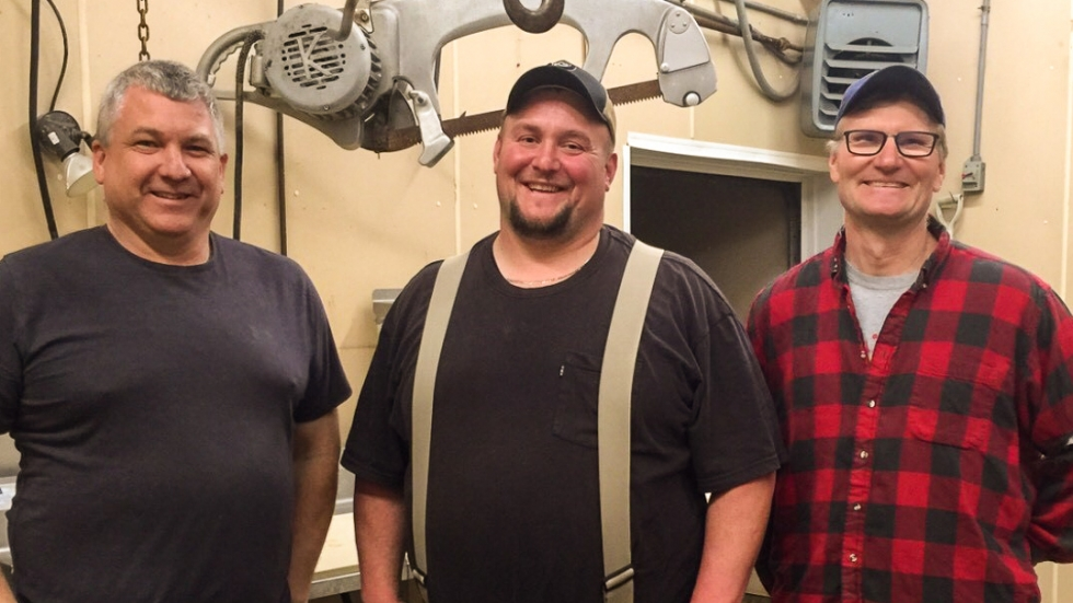 Jeremy Jenkins, center, in his meat processing shop with Rob Morey (left) and Mark Seger (right).