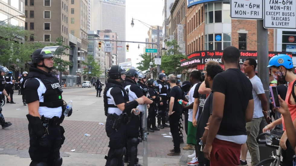Police and demonstrators on Broad and High Streets.