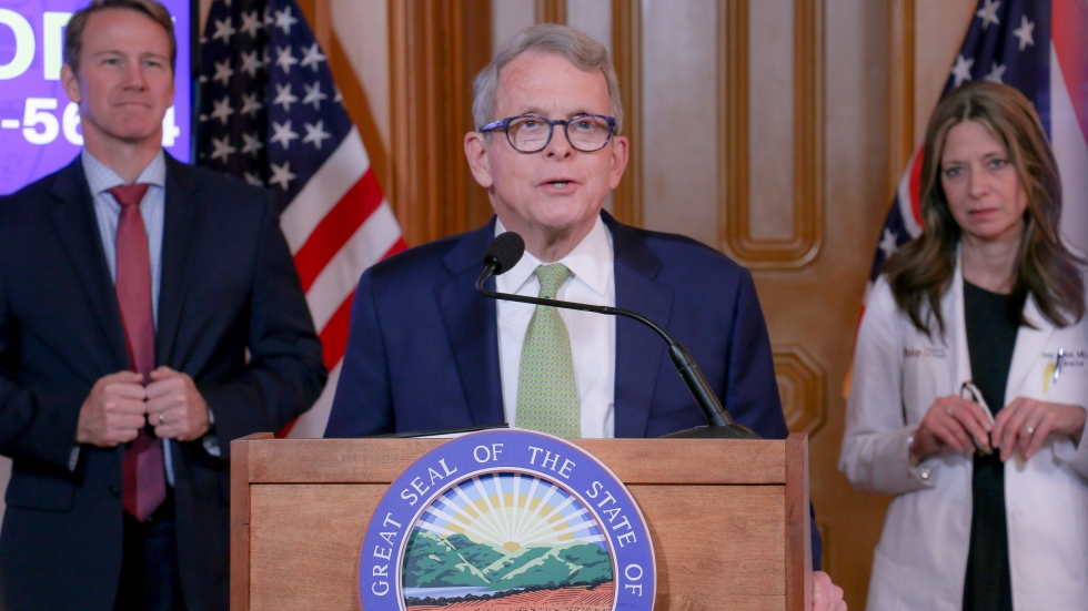 Gov. Mike DeWine speaks at his daily coronavirus press conference on March 20. Behind him are Lt. Gov. Jon Husted and Ohio Department of Health Director Dr. Amy Acton. [Office of Gov. Mike DeWine]
