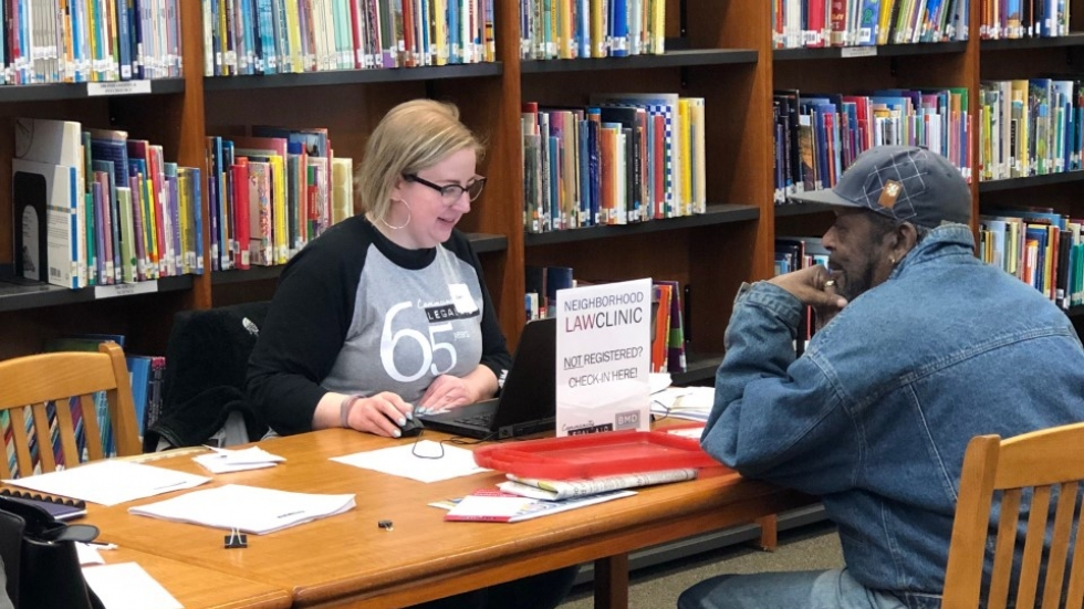 Attorney Dawn Spriggs works with a client at a Community Legal Aid outreach clinic at Mason Elementary in Akron.