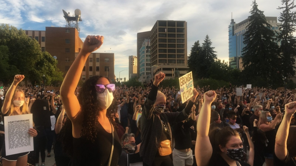 Anti-racism protesters raise their fists during a vigil against police violence in Boise, Idaho, in early June.