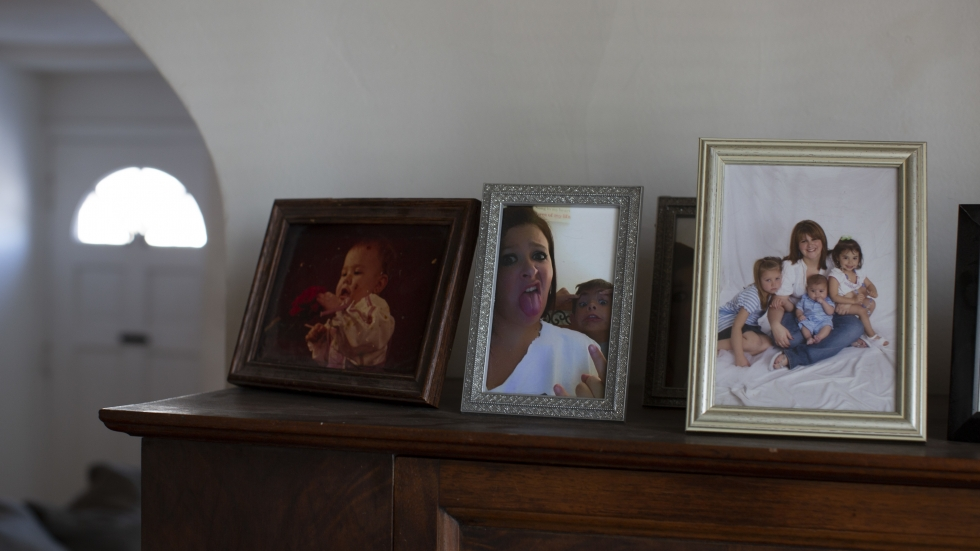 Kristen Trogler keeps family photos, including one of her as a baby and then as a mother with her three children.