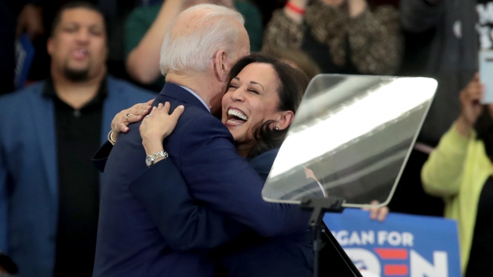 Biden and Harris hug after she endorsed and introduced him at a March 9 campaign rally in Detroit.