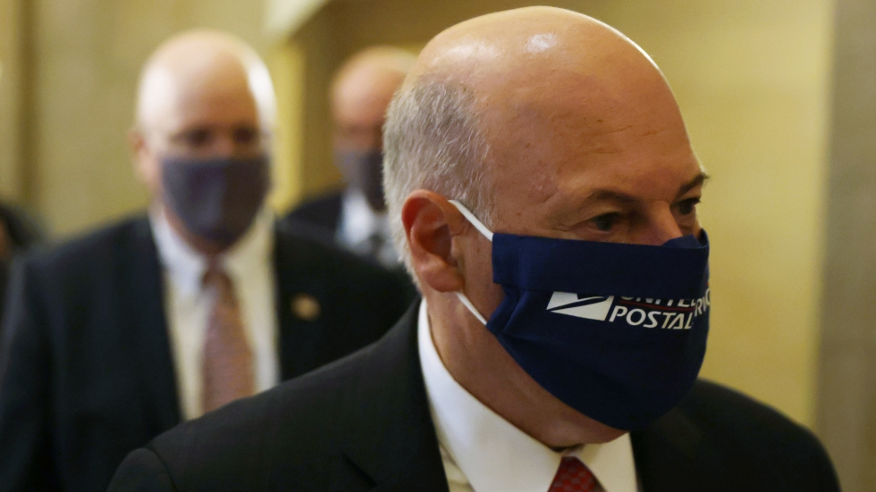 U.S. Postmaster General Louis DeJoy arrives at a meeting at the office of Speaker Nancy Pelosi on Aug. 5, 2020.