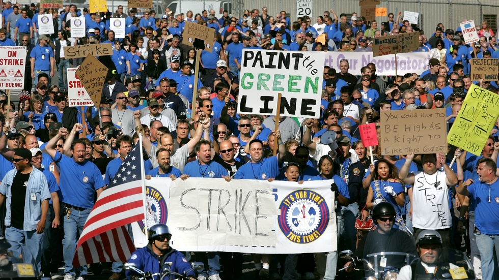In 2008, 27,000 Boeing machinists went on strike over the airline manufacturer's plans to outsource 5,000 union jobs to New Breed. DeJoy was CEO at New Breed at the time.