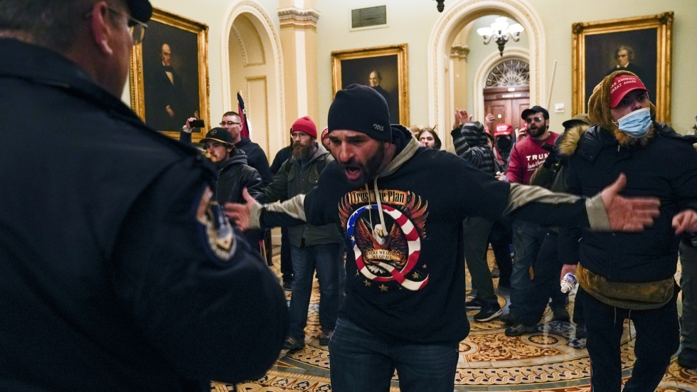 Protesters gesture to U.S. Capitol Police in the hallway outside of the Senate chamber on Wednesday.