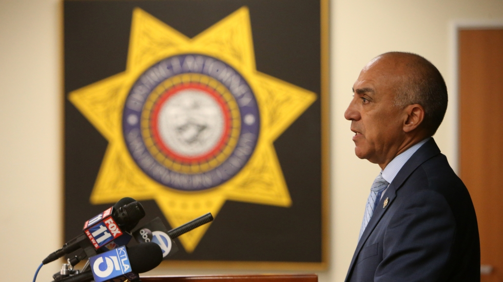San Bernardino District Attorney Michael Ramos speaks during a press conference in 2018. In an interview with NPR, the now former DA defended police officers, saying that they have an impossible job.