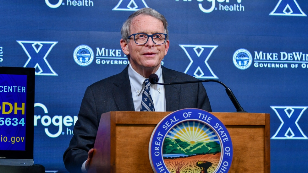 Gov. Mike DeWine visited Cincinnati's Cintas Center Thursday, March 18, the first day the Xavier University sports arena opened as a mass vaccination site. [Jason Whitman / WVXU]