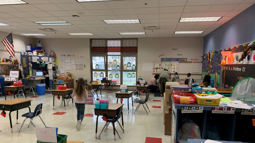 Tammy Mishak says her kids' return to the classroom meant a lot of sanitizing, but the preschoolers quickly adapted to masks and picked up their social interaction growth, at a 6-foot distance.