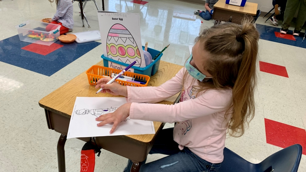 Aunabella Hughes' desk is a careful six feet from the next one. Though guidelines now allow children to sit closer together, teacher Tammy Mishak says they've established a routine the children are all comfortable with