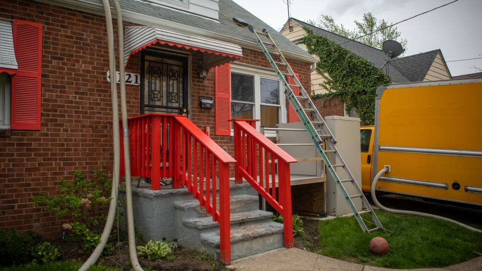 Residential housing accounts for about a fifth of the country's greenhouse gas emissions. Renovating old homes like this one can improve lives as well as help fight climate change.