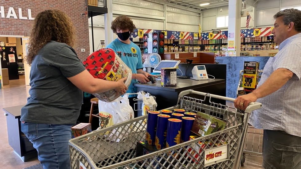 Donna Nuccio (left), store manager at Pyro City store near Lone Jack, Mo., assists a customer.