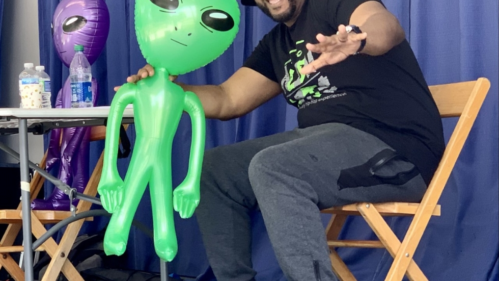 Ameer Williamson is a youth mentor and rapper, performing as Minus the Alien. He works to uplift the community and change perceptions about hip-hop culture.