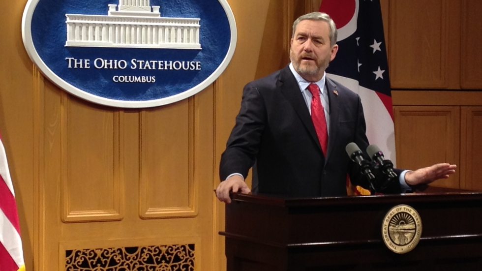 Ohio Attorney General Dave Yost at a podium in the statehouse.