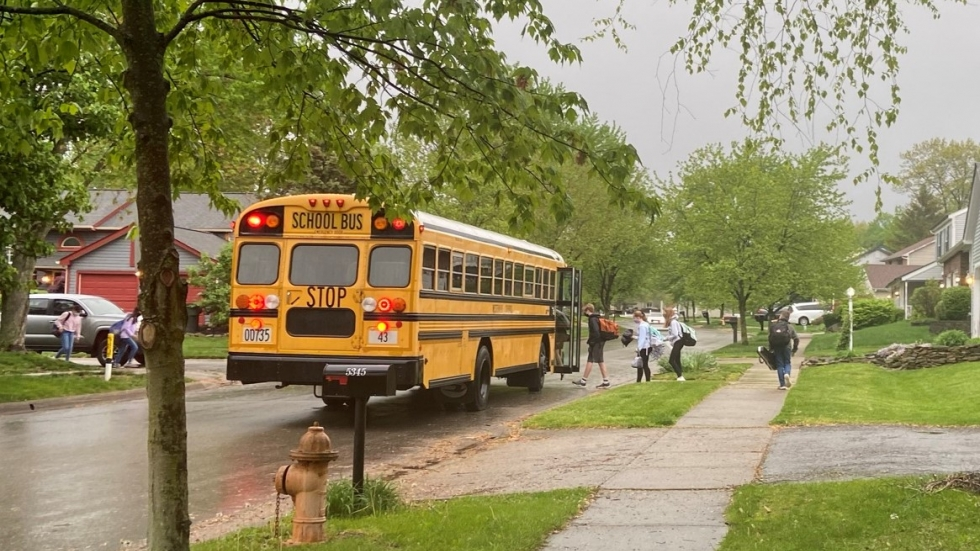 A school bus in suburban Columbus picks up students in September 2020.