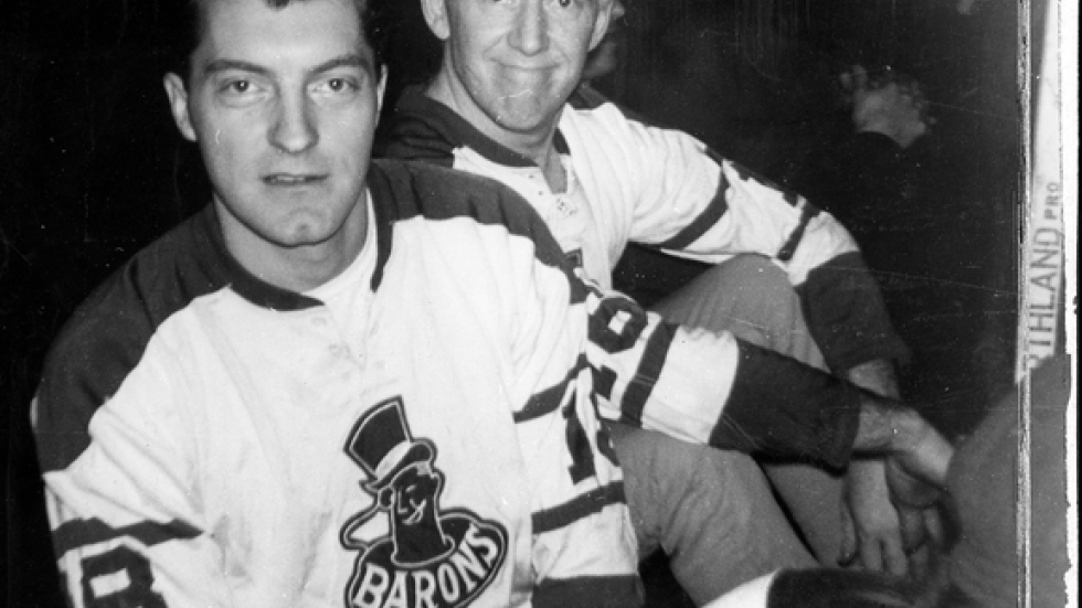 Chuck and Ernie Anderson wear Ernie jerseys from the old Cleveland Barons hockey team.