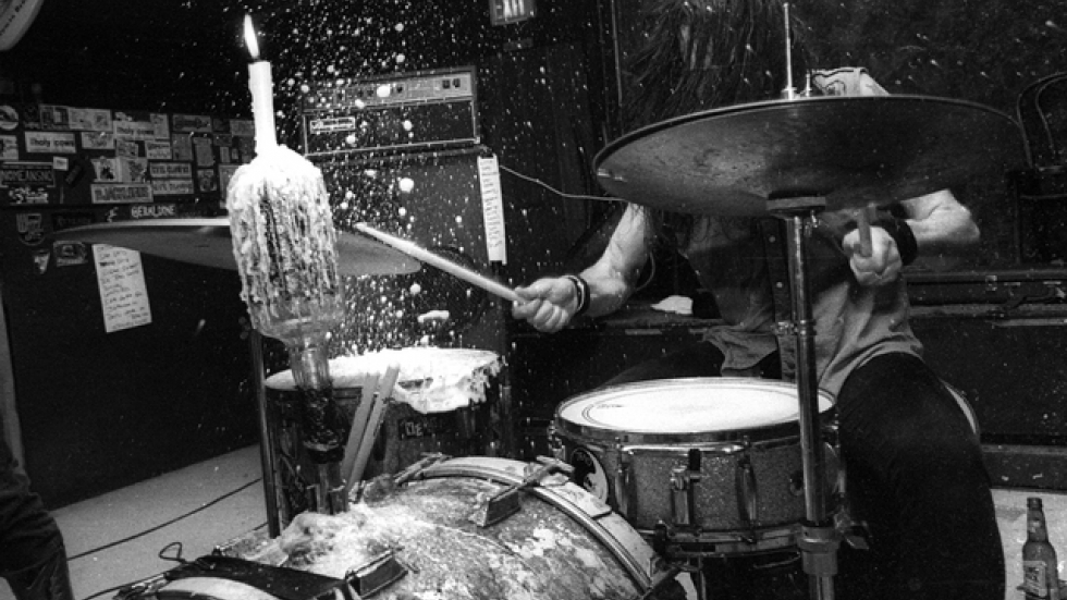 Dead Moon, influential Portland, OR garage band. That's beer exploding into the air. He had poured almost a full one on to his drum head