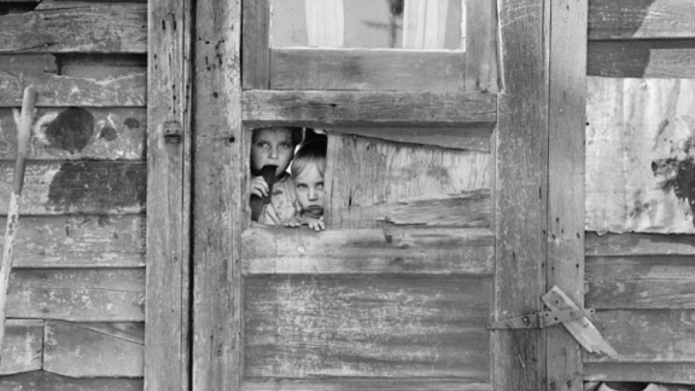 Between Weedpatch and Lamont, Kern County, California. Children living in camp By Dorothea Lange, April 20, 1940