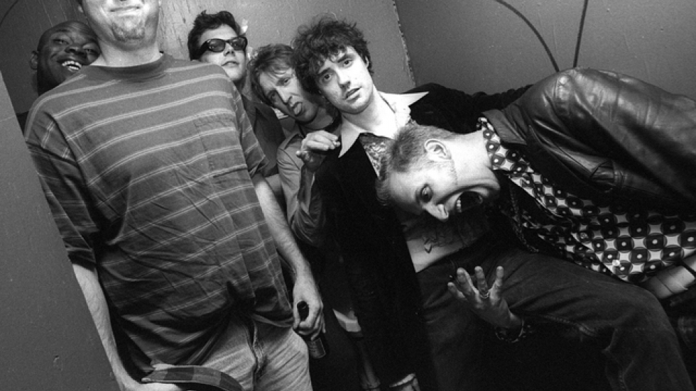 Quazi Modo, local Cleveland band, photo taken in men's room of Pat's. Guy smiling to the far left was not in the band, he was trapped stall