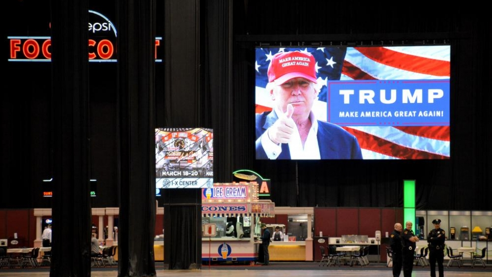 Donald Trump's image looks down from a screen at the IX Center before a March rally in Cleveland.