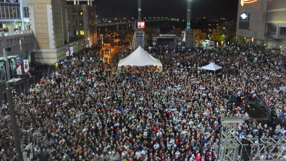 Thousands gathered between The Q and Progressive Field to wtach the game on large screens hoping for a second championship party this year.