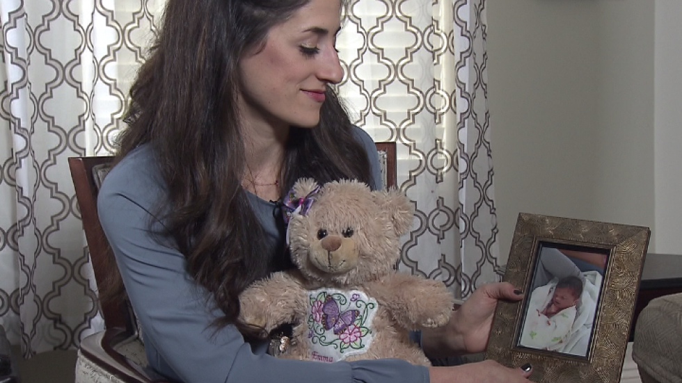 Katie Burns holds a picture of her daughter at a grief counselling center.