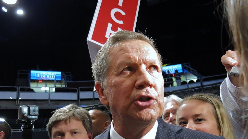 Ohio Gov. John Kasich talks with reporters after a presidential debate in 2015.