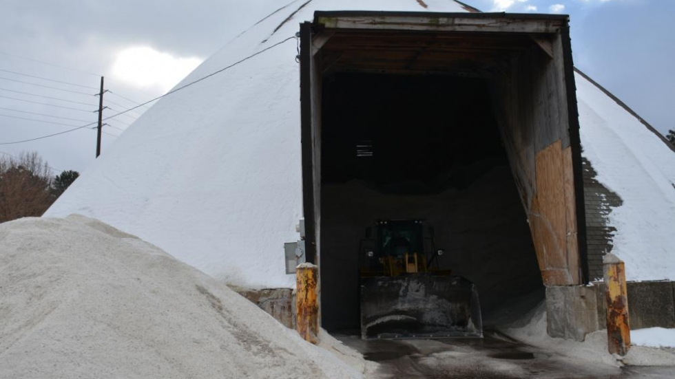 A worker unloads road salt in Cleveland.