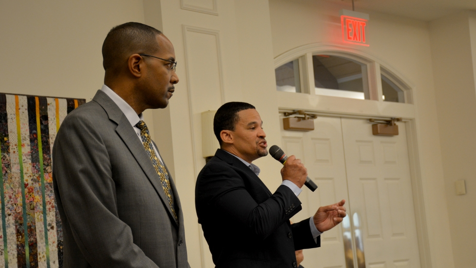 Council President Thomas Wheeler, left, and Mayor Gary Norton, right, speak at a meeting in East Cleveland.