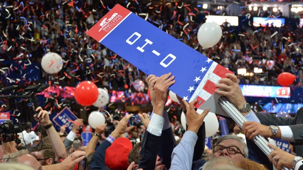 Ohio delegates remove their sign from its pole.