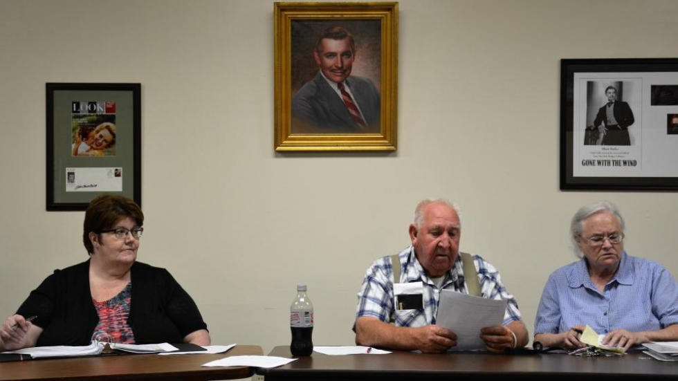 Images of Clark Gable look out over a meeting of the Harrison County GOP.