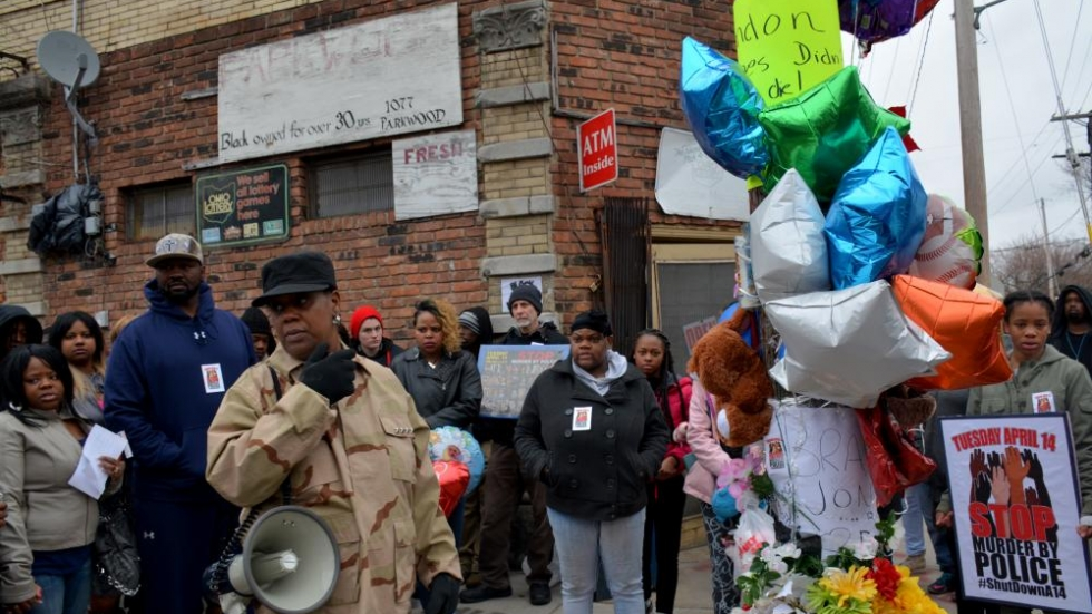 Family and others held a vigil for Brandon Jones last year outside the store where an officer shot him.