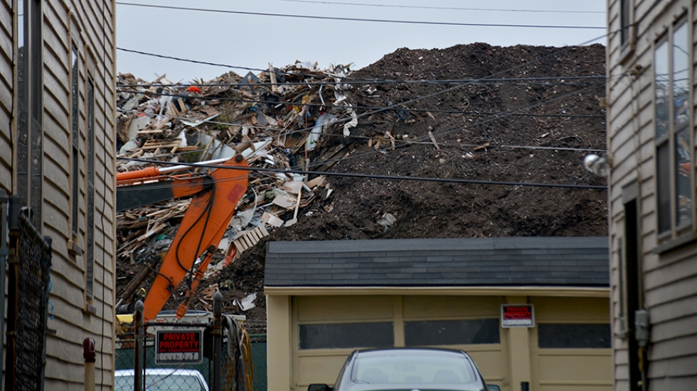 A pile of debris rises behind homes in East Cleveland.