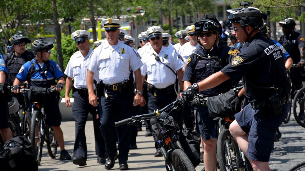 Cleveland police and out-of-town officers move through Public Square during the Republican National Convention.