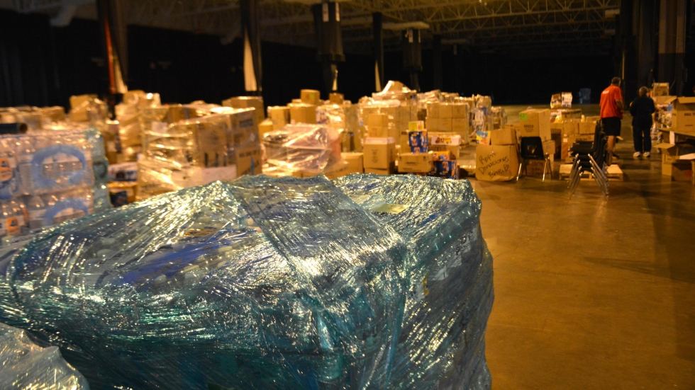 Volunteers categories supplies for Puerto Rico at the IX Center.