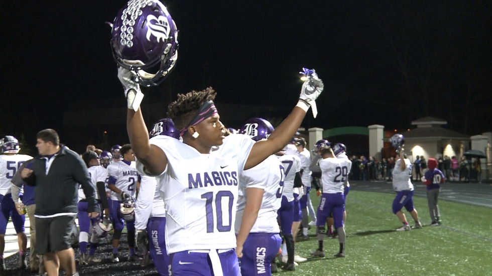 A Barberton High School football player turns to pump up the crowd during the school's game at Highland High School. (Credit: Ashton Marra/ideastream)