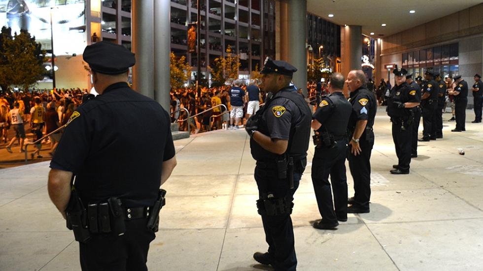 Cleveland police officers stand watch outside Quicken Loans Arena as fans celebrate the Cavaliers' NBA Championship victory in 2016.