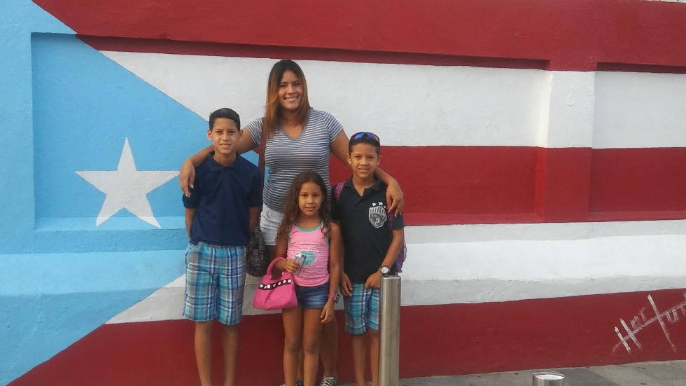 Rosario and her three children in Puerto Rico. Her husband left for Cleveland before Hurricane Maria hit the island. (Courtesy: Madalyn Rosario)
