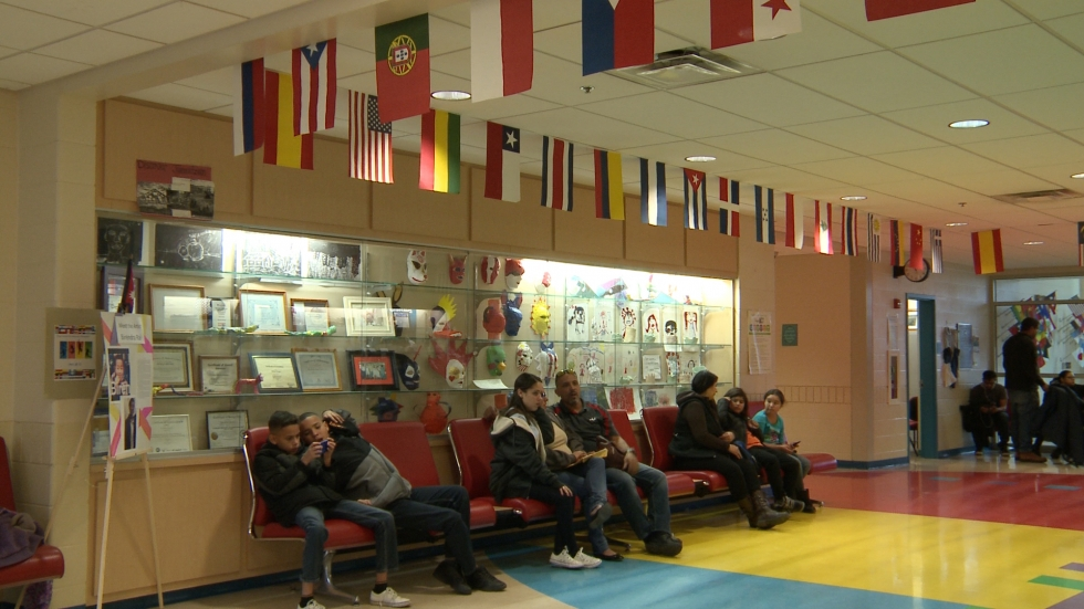 The lobby of Thomas Jefferson Elementary School has turned into a waiting room for Puerto Rican families waiting to register their children for school. (Ashton Marra/ideastream)