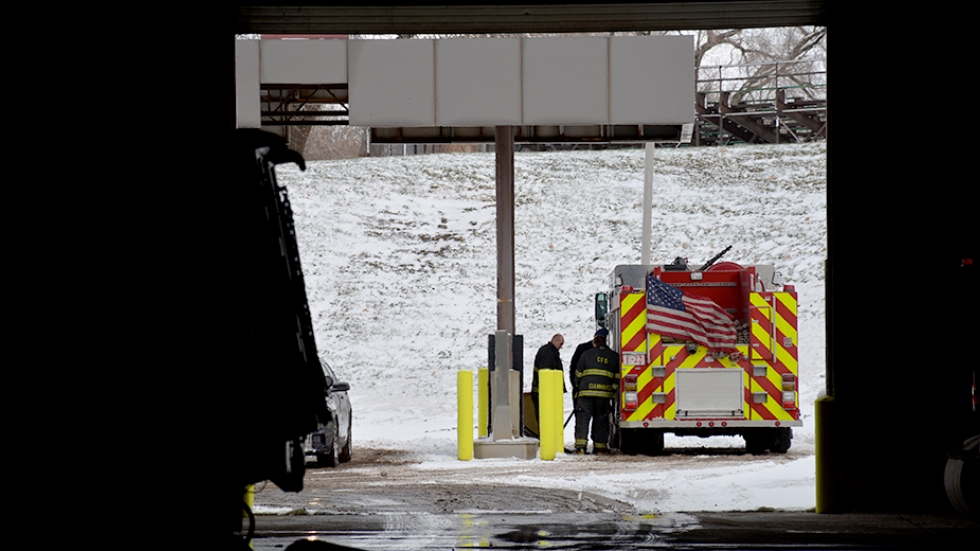 Cleveland firefighters refuel a truck at a city service center.