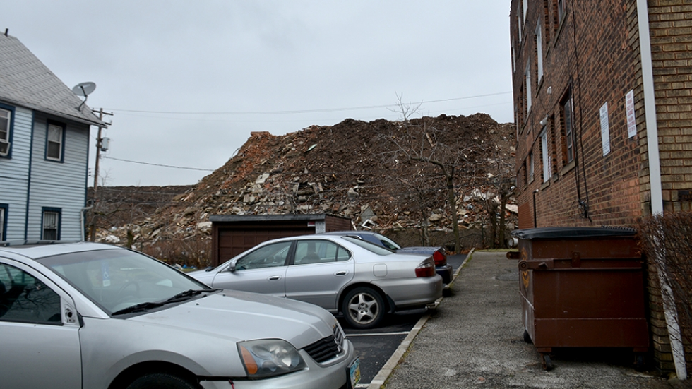 A pile of debris now sits on a site sold off by East Cleveland in 2014.