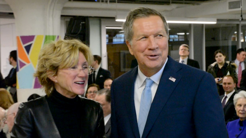 Gov. John Kasich talks with Barbara Snyder, the president of Case Western Reserve University, at an event on campus in Cleveland.