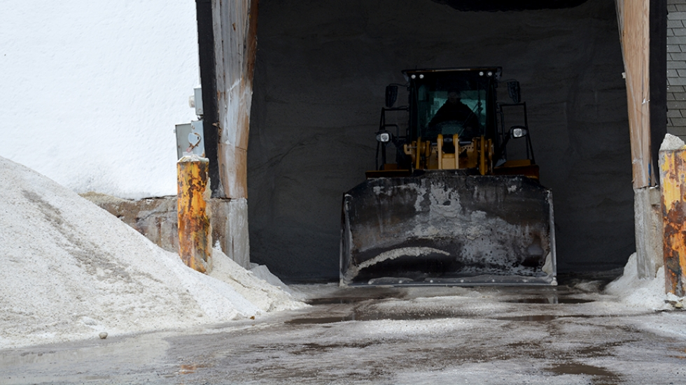 A worker prepares to move road salt at a Cleveland service facility in December 2016.