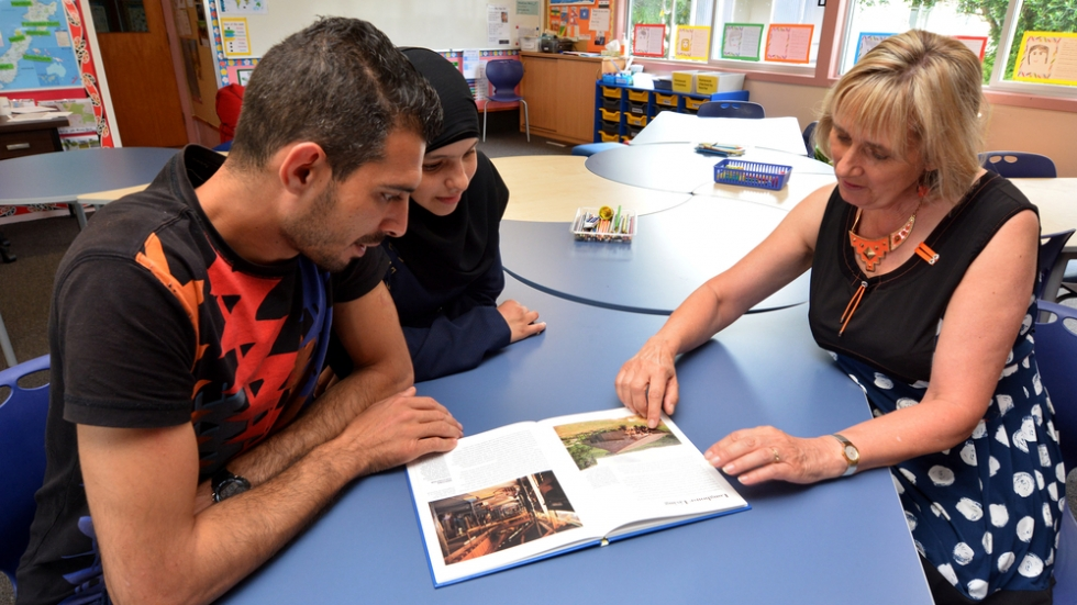 Teacher helping refugees