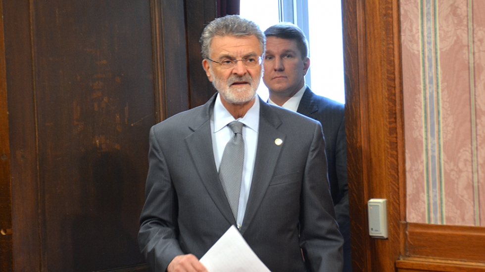 Cleveland Mayor Frank Jackson and Independence Mayor Anthony Togliatti walk into a news conference to announce the lawsuits.