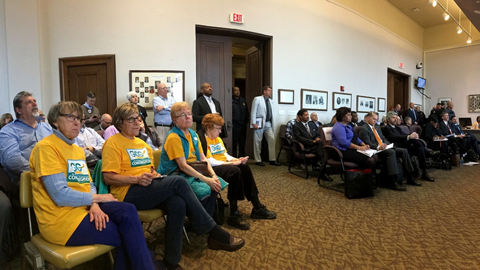 Members of Greater Cleveland Congregations and others watch council hearings on Tuesday.