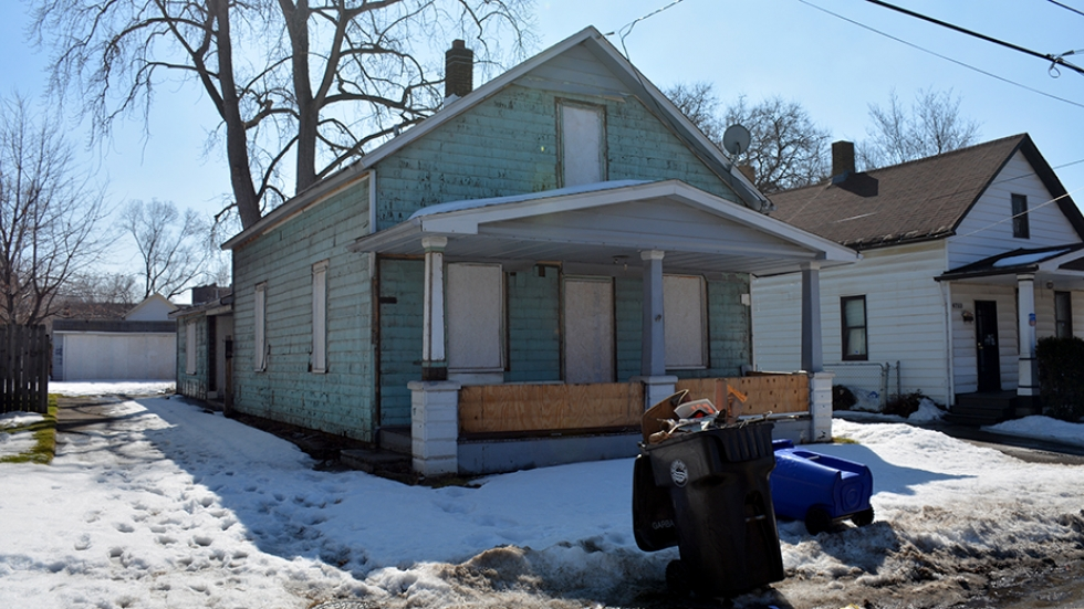 Windows and doorways are boarded up in a home in Cleveland's Slavic Village neighborhood in 2015.