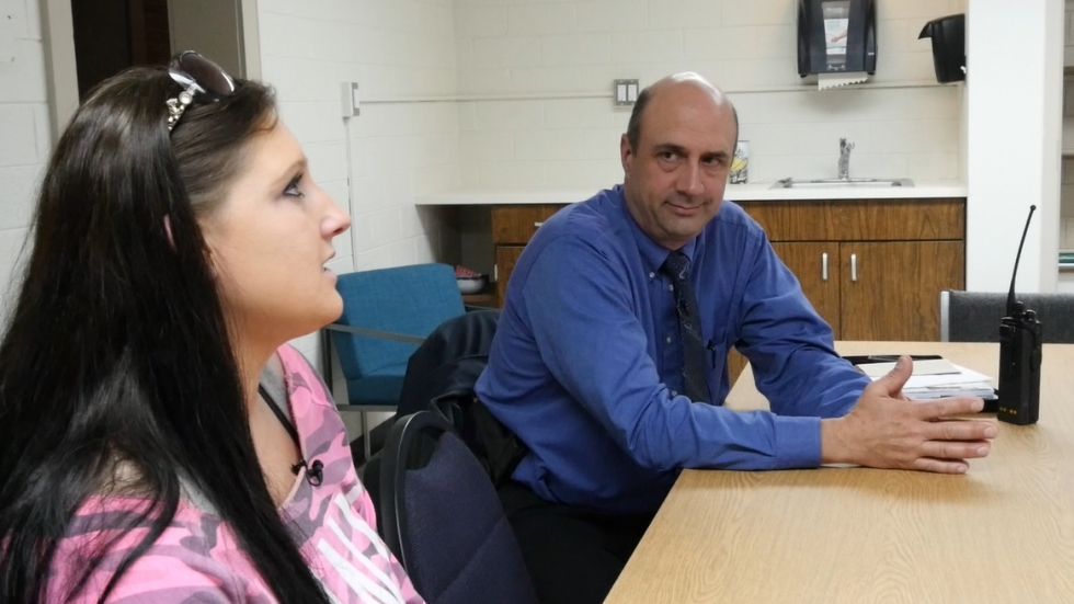 Brittany Malkowski speaks with her DART officer, Karl Schwemley, at Zepf Recovery House. (Photo: ideastream)