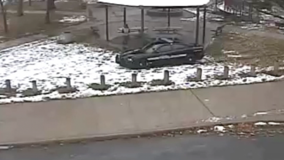 Officers Frank Garmback and Timothy Loehmann approach Tamir Rice in a zone car in this still from surveillance footage at Cudell recreation center.