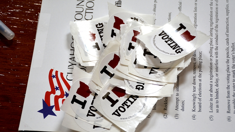 Voting stickers are displayed on a table at a Cleveland polling place in 2014.
